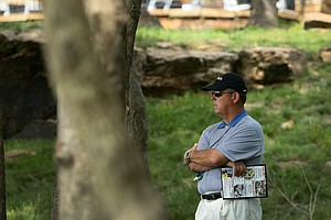 Jim Holtgrieve, the 2011 U. S. Walker Cup captain, watches from a distance at No. 18 during Wednesday stroke play at the 2011 NCAA Division I Men's Golf Championship.