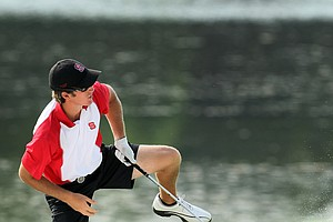 NC State's Brandon Detweiler hits a shot from the bunker at No. 18.