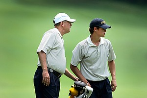 Georgia Tech head coach Bruce Heppler talks with James White during Wednesday stroke play at the NCAA Championship.