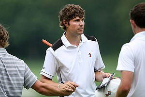 Peter Uihlein shakes hands with playing competitors following a second-round 69 at Karsten Creek.