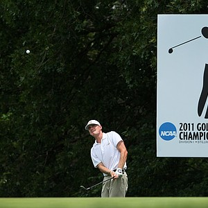 LSU's John Peterson hits a chip at No. 18 next to the leaderboard.