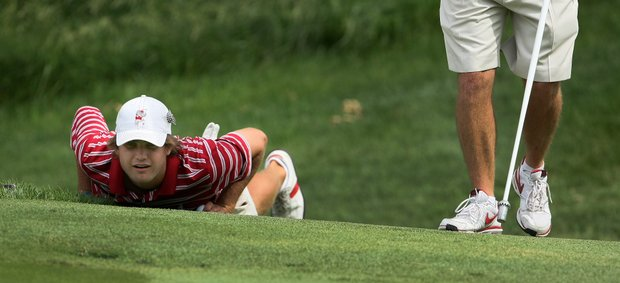 Alabama's Bobby Wyatt gets low to read a green during Thursday stroke play. Alabama did not advance to match play.