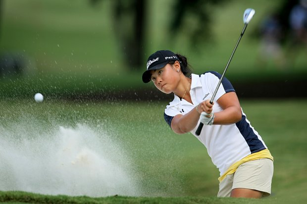 Danielle Kang hits a bunker shot at No. 18 during Thursday's Round of 16 at the 2010 Women's Amateur at Charlotte Country Club, August 10, 2010.