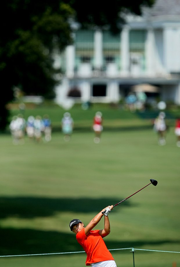 The clubhouse can be seen in the background as Danielle Kang hits her tee shot at No. 12 during Friday's quarterfinals of the 2010 Women's Amateur at Charlotte Country Club, August 13, 2010