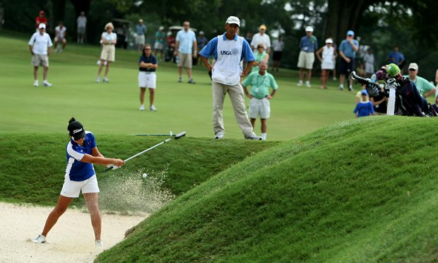 Danielle Kang hits out of a greenside bunker at No. 2 during Saturday's semifinals of the 2010 Women's Amateur at Charlotte Country Club, August 14, 2010.