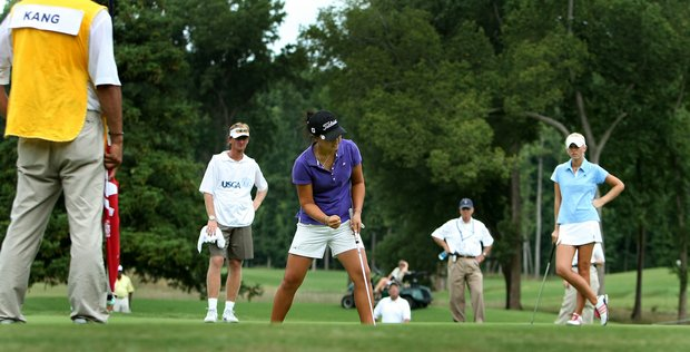 Danielle Kang makes par at No. 14 to halve the hole during the first 18 holes of Sunday's finals at the 2010 Women's Amateur at Charlotte Country Club, August 15, 2010.