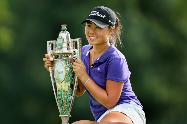 Danielle Kang is the 2010 Women's Amateur Champion at Charlotte Country Club, August 15, 2010. Kang defeated Jessica Korda, 2 & 1. She poses with the Robert Cox Trophy.