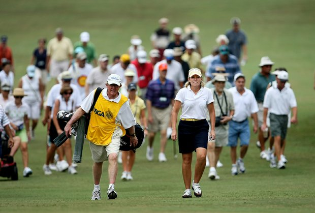 Martha Leach and her husband/caddie, John, walk up No. 9 during the 23rd U.S. Women's Mid Amateur Championship at Golden Hills Golf & Turf Club.