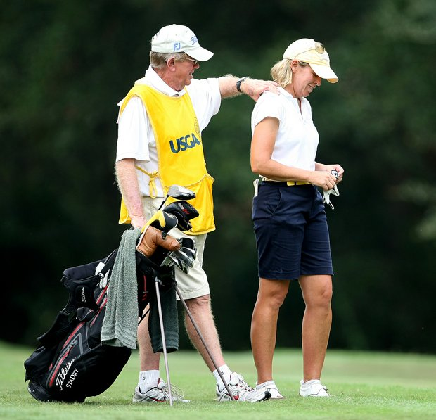 Martha Leach's caddie/husband, John, gives Leach a shoulder massage at No. 13 during the 2009 U.S. Women's Mid Amateur Championship at Golden Hills Golf & Turf Club.