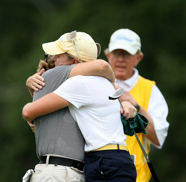 Martha Leach, right, hugs her opponent, Laura Coble after she defeated Coble, 3 and 2, during the 2009 U.S. Women's Mid Amateur Championship at Golden Hills Golf & Turf Club.