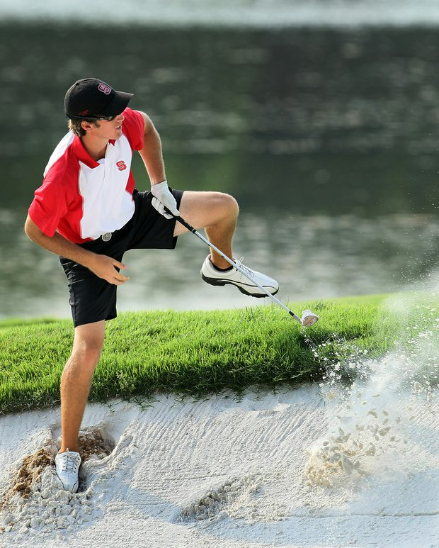 N.C. State's Brandon Detweiler hits a shot out of a bunker at Karsten Creek's 18th.