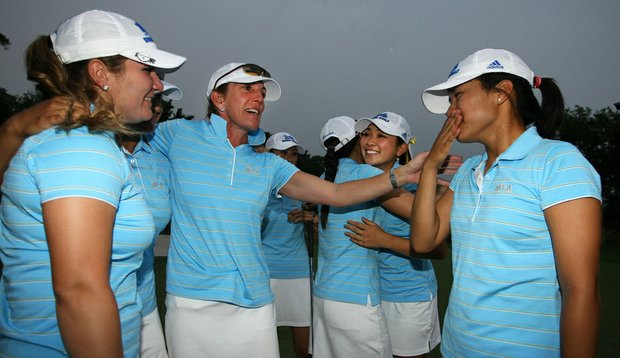 UCLA head coach Carrie Forsyth (second from left) celebrates with her team after winning the national championship.