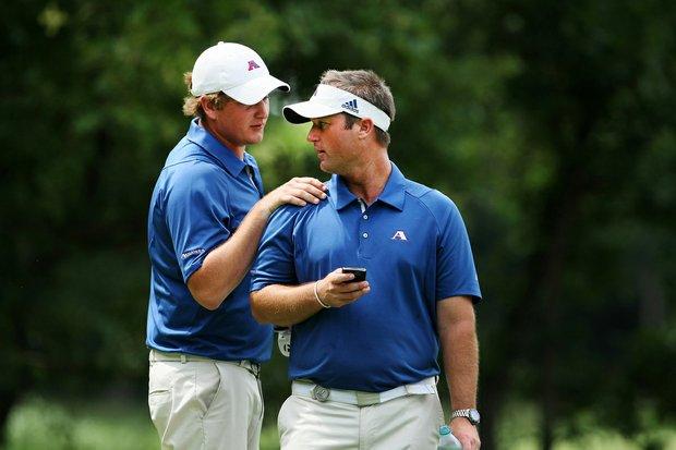 Augusta State head coach Josh Gregory (right) speaks with Henrik Norlander.