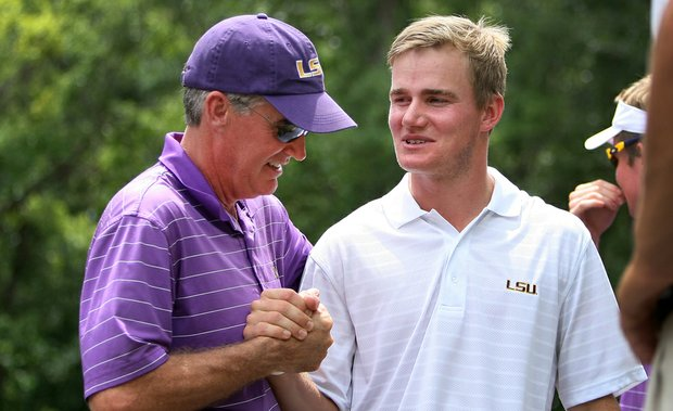 LSU senior John Peterson (right) is congratulated by his father, David, after Thursday's third round of the NCAA Championship.