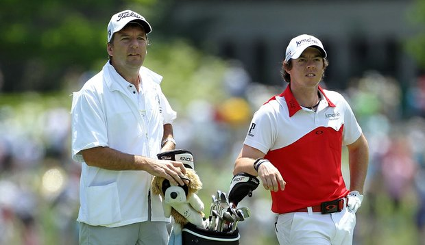Rory McIlroy waits in the 10th fairway at Muirfield Village with his caddie during the first round of The Memorial.