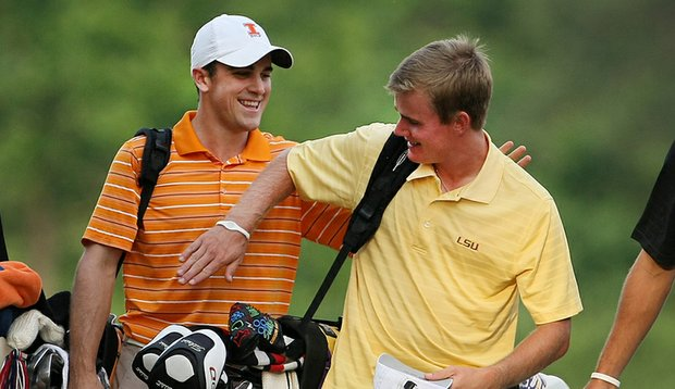 LSU's John Peterson (right) gets a clap on the back from 2010 NCAA champion Scott Langley of Illinois.