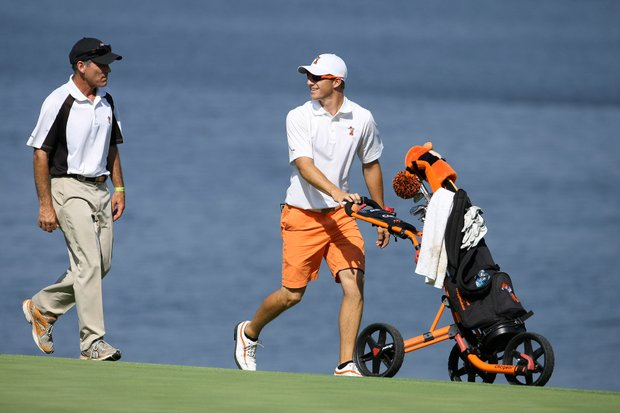 Oklahoma State's Morgan Hoffmann walks up No. 17 with head coach, Mike McGraw during Quarterfinals.