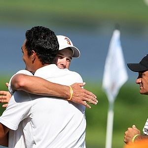 Oklahoma State's Kevin Tway celebrates his win with teammate Sean Einhaus during Quarterfinals. OSU faces Augusta State in the Semifinals.