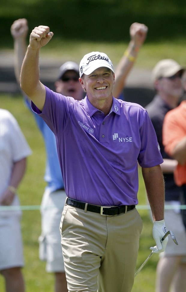 Steve Stricker celebrates after holing out a shot from the fairway for an eagle on the second hole during the third round of the Memorial golf tournament at Muirfield Village Golf Club, Saturday, June 4, 2011, in Dublin, Ohio.