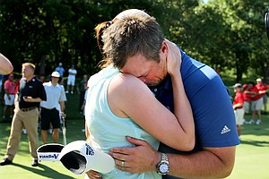 Augusta State head coach Josh Gregory embraces his wife Ashley after the Jaguars defended their national title at the 2011 NCAA Division I Men's Golf Championship at Karsten Creek in Stillwater, Oklahoma. Gregory will be moving to SMU as its head coach next season.