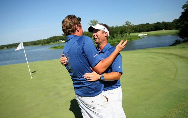 Augusta State's Henrik Norlander and head coach Josh Gregory celebrate after the 2011 NCAA Division I Men's Golf Championship at Karsten Creek in Stillwater, Oklahoma.