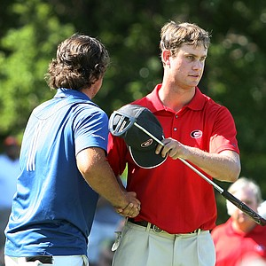 Augusta State's Patrick Reed and Georgia's Harris English shake hands after their final match during the finals of Sunday's Match Play at the 2011 NCAA Division I Men's Golf Championship at Karsten Creek in Stillwater, Oklahoma. Reed won the match, 2 and 1.