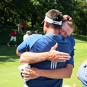Augusta State head coach Josh Gregory shares an embrace with Carter Newman after they won the 2011 NCAA Division I Men's Golf Championship at Karsten Creek in Stillwater, Oklahoma. Newman won his match, 7 and 5.