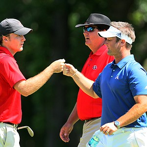 Augusta State head coach Josh Gregory fist bumps Georgia's Russell Henley after he chipped in at No. 13 during the finals of Sunday's Match Play at the 2011 NCAA Division I Men's Golf Championship at Karsten Creek in Stillwater, Oklahoma. Henley would win his match, 3 and 2.