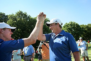 Augusta State's Mitchell Krywulycz, left, and Henrik Norlander celebrate after the 2011 NCAA Division I Men's Golf Championship at Karsten Creek in Stillwater, Oklahoma.