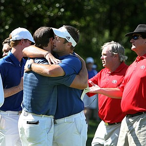 Augusta State head coach Josh Gregory hugs the women's head coach Kevin McPherson after Augusta State won the 2011 NCAA Division I Men's Golf Championship at Karsten Creek in Stillwater, Oklahoma. McPherson was acting as assistant all week. Gregory will be moving to SMU as its head coach next season.
