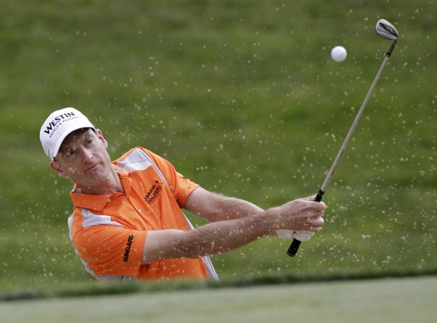 Jim Furyk hits out of a sand trap on the seventh hole during the second round for the Memorial golf tournament at the Muirfield Village Golf Club in Dublin, Ohio, Friday, June 3, 2011.