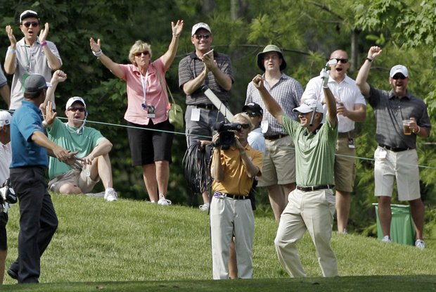 Steve Stricker, front right, celebrates after getting a hole-in-one on the eighth hole during the second round for the Memorial golf tournament at the Muirfield Village Golf Club in Dublin, Ohio, Friday, June 3, 2011. Stricker finished at 9-under par after the second round.