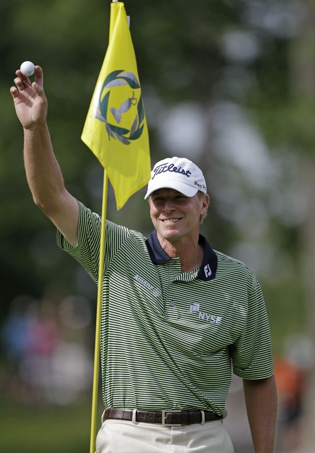 Steve Stricker is all smiles as he waves to the gallery after getting a hole-in-one on the eighth hole during the second round for the Memorial golf tournament at the Muirfield Village Golf Club in Dublin, Ohio, Friday, June 3, 2011. Stricker finished with a two-day score of 9-under par.