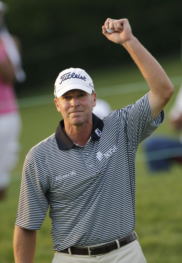 Steve Stricker celebrates after winning the Memorial golf tournament at Muirfield Village Golf Club in Dublin, Ohio Sunday, June 5, 2011.