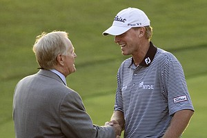 Jack Nicklaus, left, congratulates Steve Stricker for winning the Memorial golf tournament at Muirfield Village Golf Club in Dublin, Ohio Sunday, June 5, 2011. Stricker finished at 16-under par, one shot better than Matt Kuchar and Brandt Jobe.