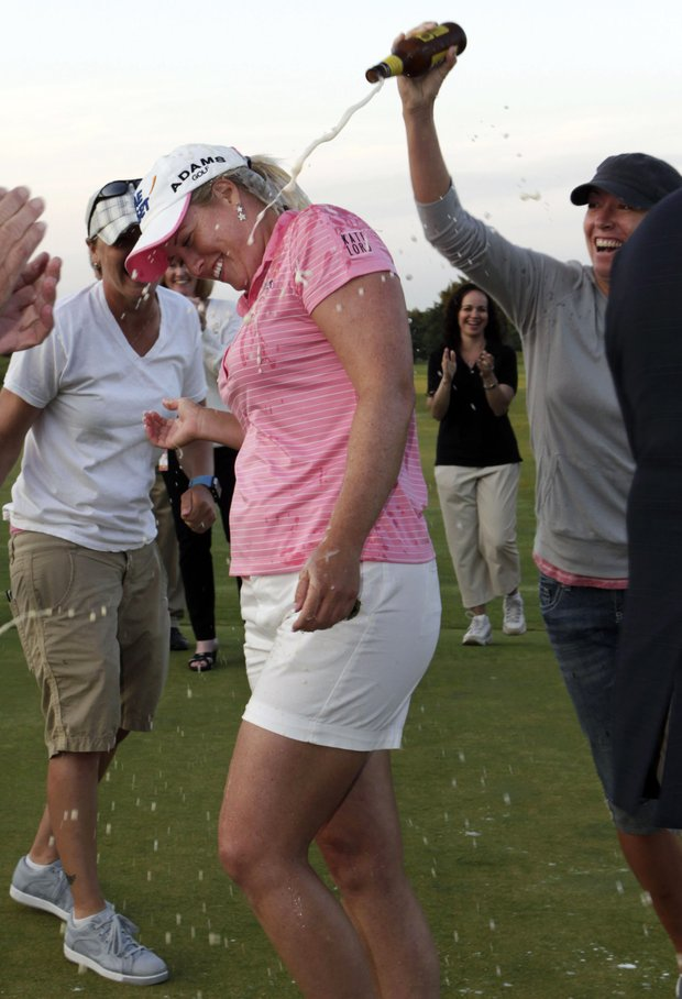 Brittany Lincicome is doused with beer by former player Danielle Downey, right, and others after Lincicome won the LPGA ShopRite Classic golf tournament in Galloway Township, N.J., Sunday, June 5, 2011. Lincicome won with an 11 under, 202 total for her first win in two years.