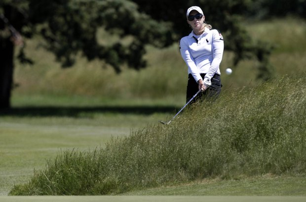 Morgan Pressel hits from the rough on the 11th hole during first round play at the ShopRite LPGA Classic golf tournament in Galloway Township, N.J., Friday, June 3, 2011.