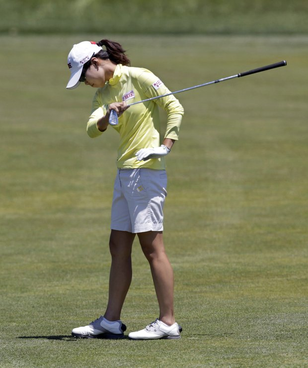Song-Hee Kim, of South Korea, reacts after her shot on the ninth hole during first round play at the ShopRite LPGA Classic golf tournament in Galloway Township, N.J., Friday, June 3, 2011.