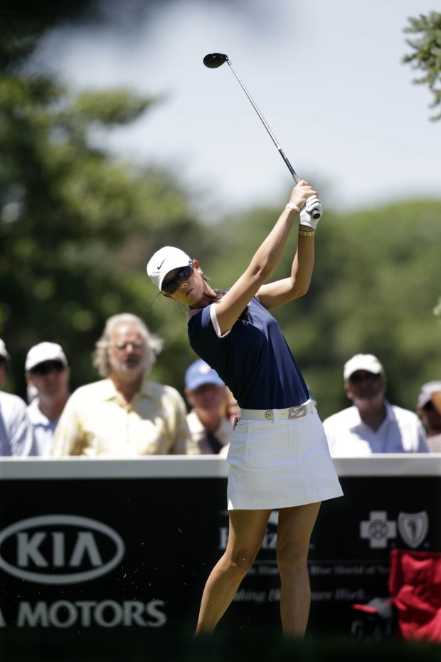 Michelle Wie hits a tee shot on the 12th hole during first round play at the ShopRite LPGA Classic golf tournament in Galloway Township, N.J., Friday, June 3, 2011.