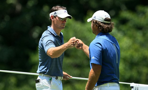 Augusta State's Patrick Reed (right) fist-bumps assistant Kevin McPherson during the finals of the NCAA Championship on June 5.