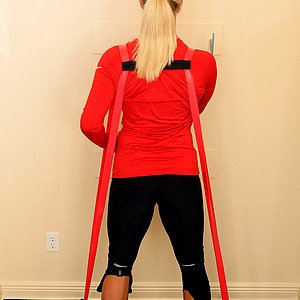 Suzann Pettersen demonstrating fitness in her home gym with trainer Dave Herman for Golfweek Style Issue.