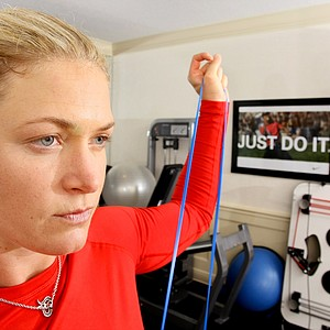 Suzann Pettersen demonstrating fitness in her home gym for Golfweek Style Issue.