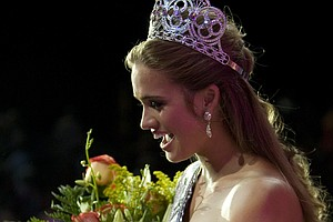 In this image provided by the Miss Universe pagent Stormi Bree Henley, 18, of Crossville, TN, reacts after being crowned Miss Teen USA 2009 by Stevi Perry, Miss Teen USA 2008 from ATLANTIS, Paradise Island, in the Bahamas Friday, July 31, 2009.