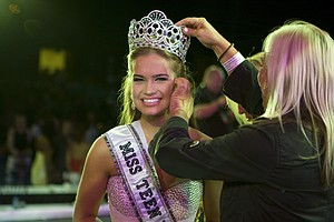 In this image provided by the Miss Universe pagent Stormi Bree Henley, 18, of Crossville, TN, gets some touch up from Hair Stylist Linda Osgood at the ATLANTIS, Paradise Island, in the Bahamas Friday, July 31, 2009.