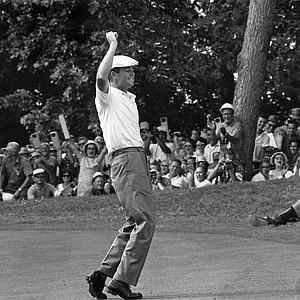 Golfer Ken Venturi reacts to a birdie putt on the ninth green during the third round of the National Open (U.S. Open) at Congressional Country Club in Bethesda, Md., on Saturday, June 20, 1964.