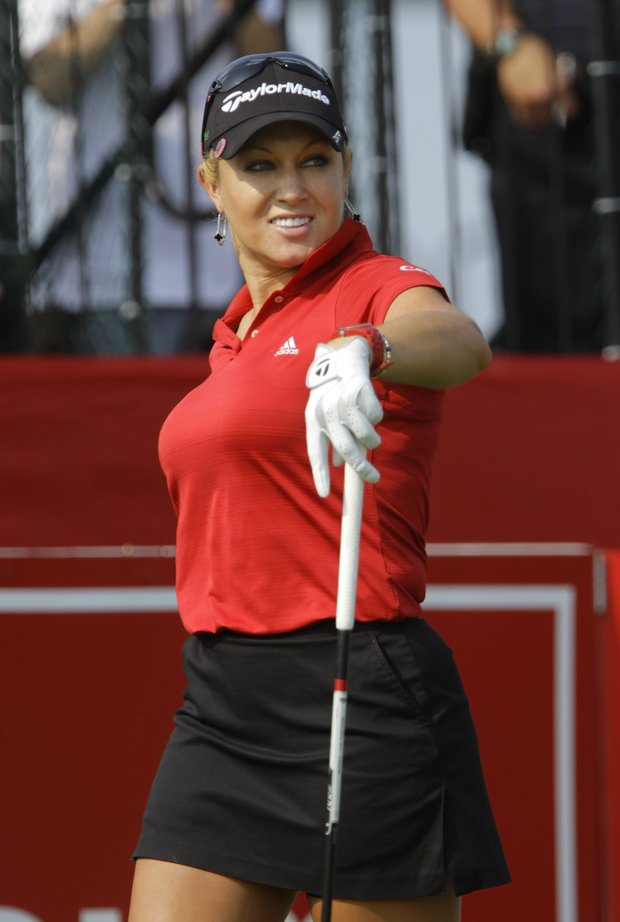 Natalie Gulbis watches her drive off the tenth tee during the first round of the LPGA State Farm Classic golf tournament in Springfield, Ill., Thursday, June 9, 2011.