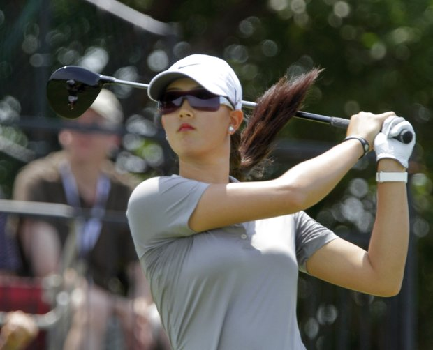 Michelle Wie, of Honolulu, Hawaii, drives off the first tee during the first round of the LPGA State Farm Classic golf tournament in Springfield, Ill., Thursday, June 9, 2011.