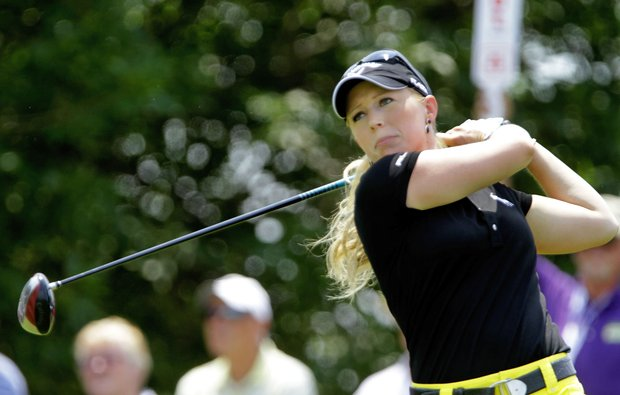 Morgan Pressel, of Bocca Raton, Fla., drives off the first tee during the first round of the LPGA State Farm Classic golf tournament in Springfield, Ill., Thursday, June 9, 2011.