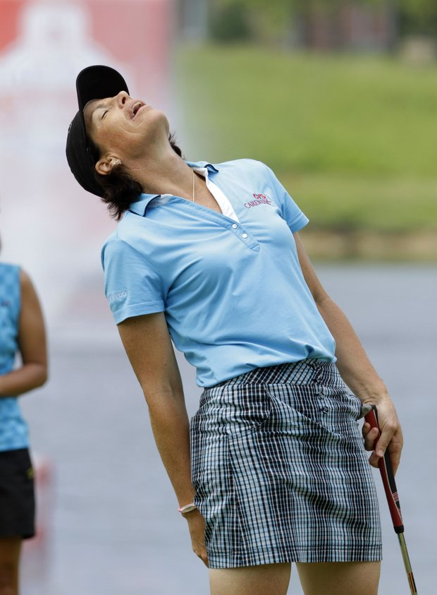 Juli Inkster reacts after missing a putt on the 18th hole during the second round of the LPGA State Farm Classic golf tournament Friday, June 10, 2011, in Springfield, Ill.