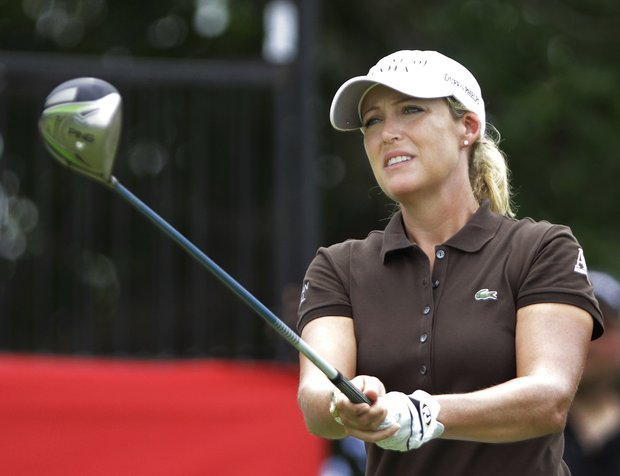 Defending champion Cristie Kerr watches her drive off the first tee during the second round of the LPGA State Farm Classic golf tournament on Friday, June 10, 2011, in Springfield, Ill.